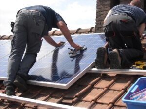 solar-panels-two men fitting to roof of house
